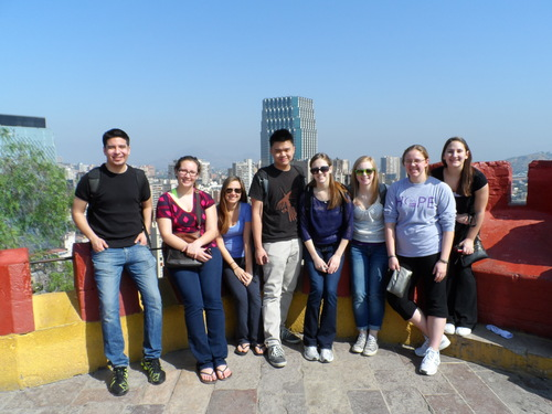Nursing students pose on rooftop in Santiago, Chile