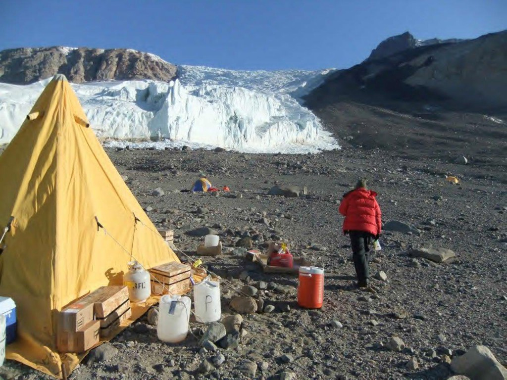 Mari walking to her tent, with Rhone Glacier in the background.
