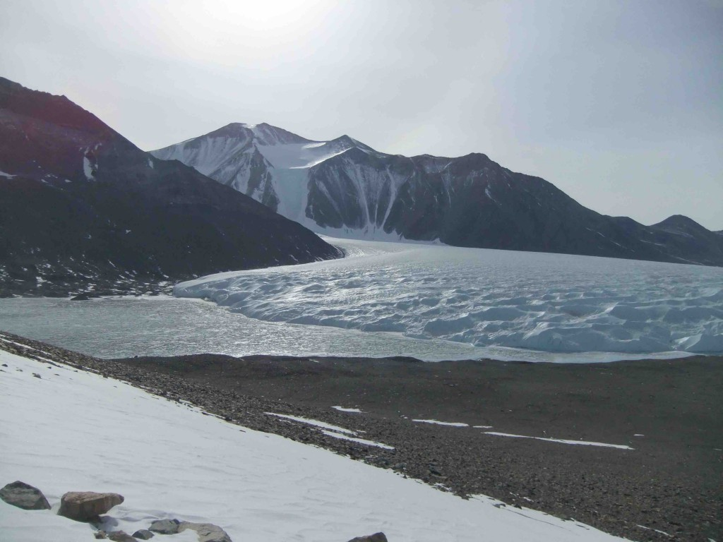 Lake Hoare camp is nestled between the lake, Canada Glacier, and the mountainside on the center left.