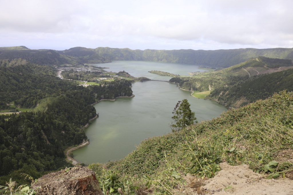 Lagoa das Sete Cidades is a twin lake situated in the crater of a dormant volcano on the Portuguese archipelago of the Azores. It consists of two small, ecologically different lakes connected by a narrow strait, which is crossed by a bridge.