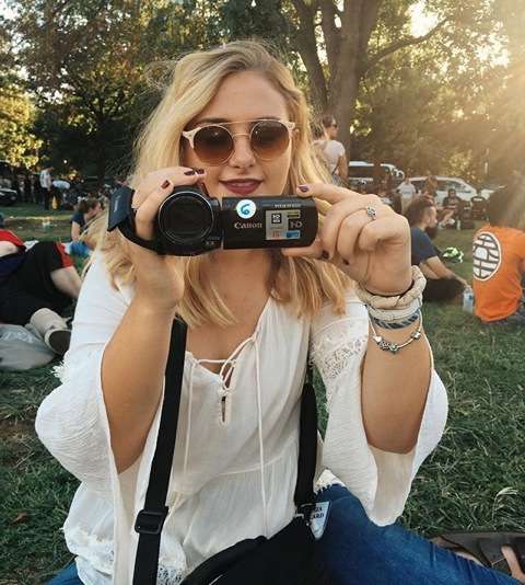 Meaghan Gallagher-Stack holding a video camera.