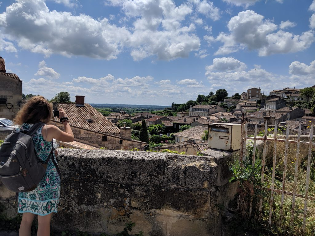 Xiomara Matathias taking a picture of historic homes in France.