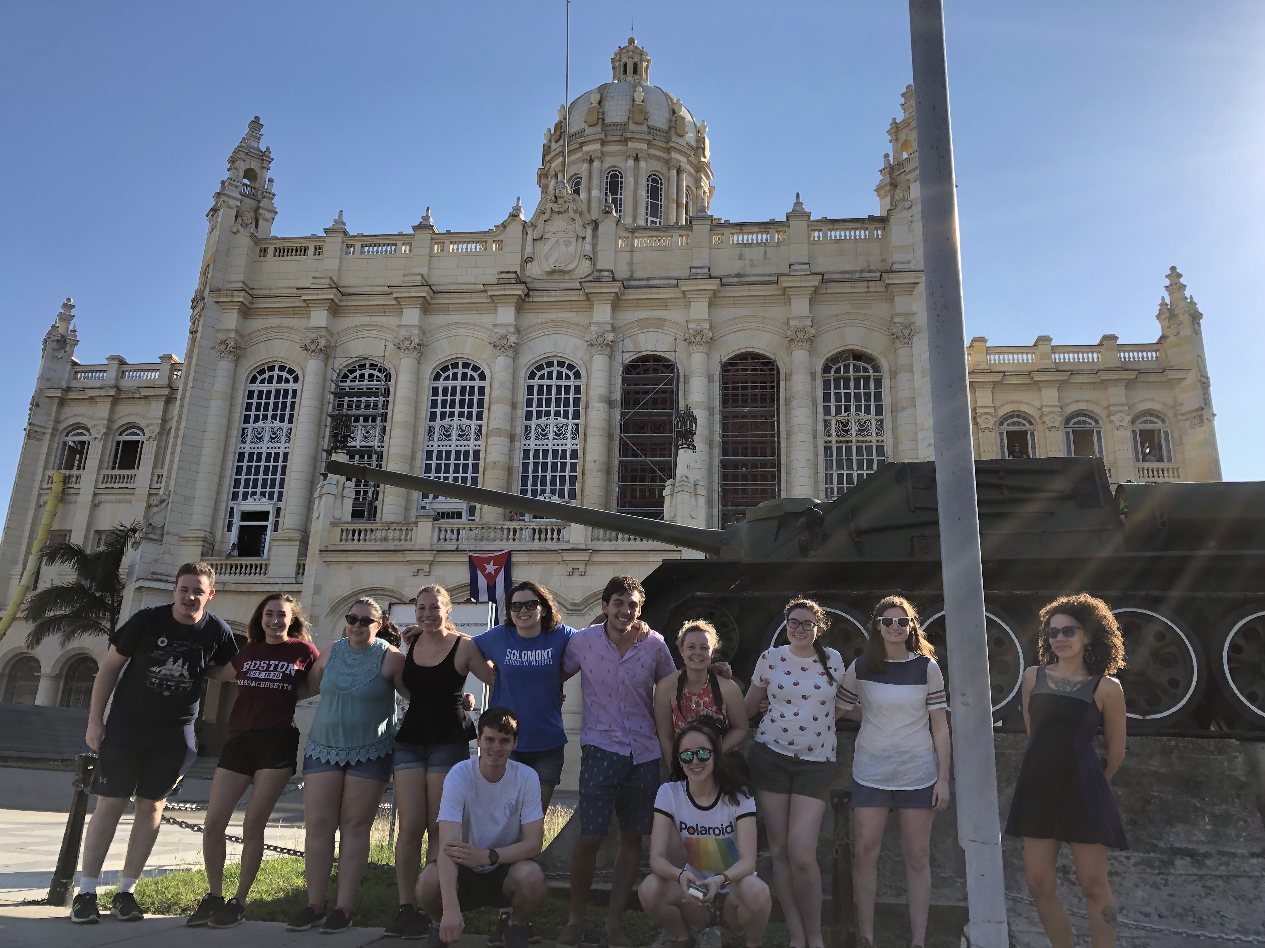 Honors students stand next to a tank outside of the Museum of the Revolution in Havana.