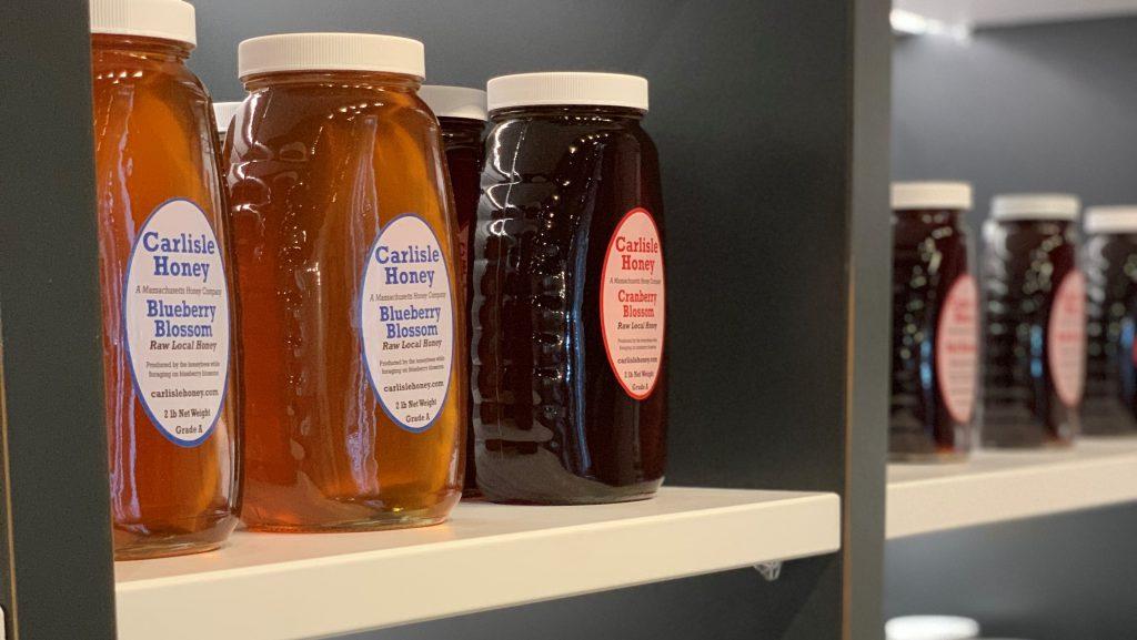 Jars of honey on shelf