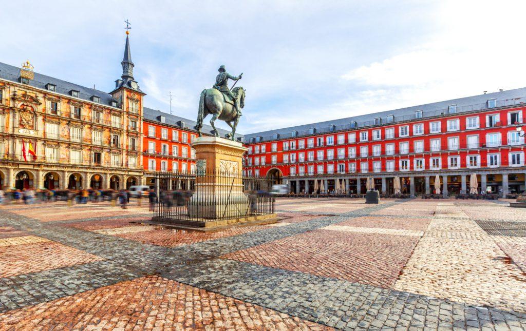 A street-level photo of Madrid's Plaza Mayor.