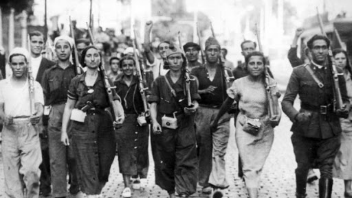 A group of female soldiers face the camera with rifles over their shoulders.