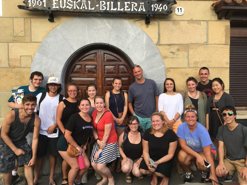 A group of Honors College students stand outside Euskal Billera, one of the oldest cooking societies in the city of San Sebastian.