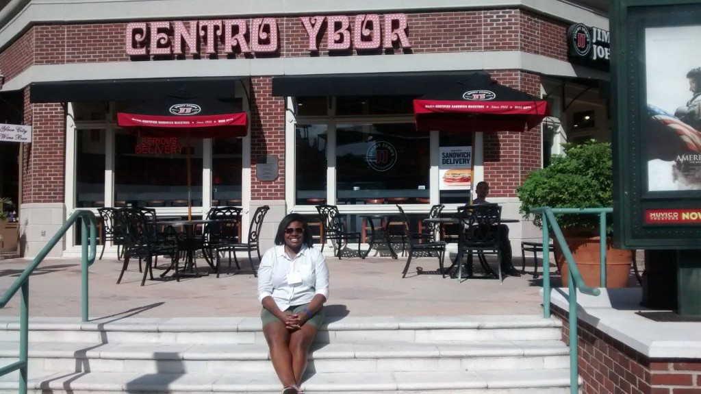 Nikquania Gamble sitting in front of the Centro Ybor which includes a Jimmy John's restaurant., in Tampa, Florida